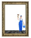 Cubiertas del pintor de casas dentro del marco vacío Fotos de archivo libres de regalías