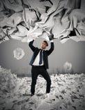 Cubierto por una lluvia de documentos de la burocracia Imagen de archivo libre de regalías