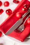 Cubierto temático rojo de la Navidad Imágenes de archivo libres de regalías