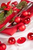 Cubierto temático rojo de la Navidad Fotos de archivo libres de regalías