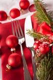 Cubierto temático rojo de la Navidad Imagenes de archivo