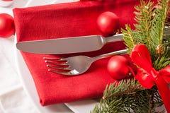 Cubierto temático rojo de la Navidad Imagen de archivo