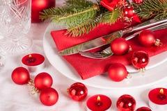 Cubierto temático rojo de la Navidad Imagen de archivo libre de regalías