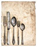Cubiertos antiguos y vieja página del libro del cocinero Fotografía de archivo libre de regalías