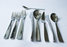 Cubiertos, bifurcaciones, cucharas y cuchillos fotos de archivo