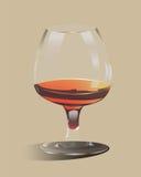 Cubilete de cristal llenado de alcohol Foto de archivo libre de regalías