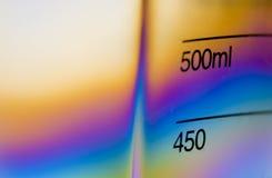 Cubilete de medición plástico claro Fotos de archivo libres de regalías