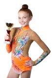 Cubilete de oro de la muchacha del atleta del ganador Imágenes de archivo libres de regalías