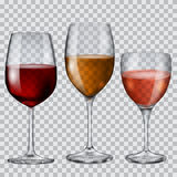 Cubiletes de cristal transparentes con el vino Foto de archivo