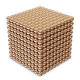 Cubique hecho de esferas de oro Imagenes de archivo