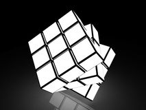 Cubo con imágenes ligeras en un fondo negro Imagen de archivo