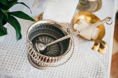 Cubo de agua santa de plata Imagen de archivo libre de regalías