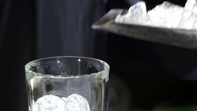 Cubo de gelo isolado no branco Fim acima Movimento lento vídeos de arquivo