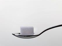 Cubo dello zucchero bianco immagine stock