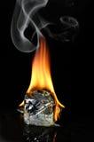 Cubo di ghiaccio Burning Immagini Stock