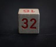 Cubo di legno con il numero trentadue Fotografia Stock Libera da Diritti