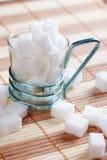 Cubo do açúcar no copo Imagem de Stock