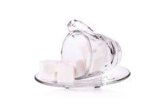 Cubo do açúcar no copo de café Imagem de Stock Royalty Free
