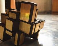 Cubo dourado imagem de stock