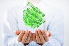 Cubo na mão masculina Meios mistos Imagem de Stock Royalty Free