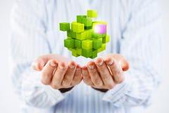 Cubo na mão masculina Meios mistos Fotografia de Stock Royalty Free