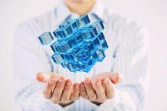 Cubo na mão masculina Meios mistos Fotografia de Stock
