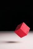 Cubo rojo flotante del rompecabezas Imagen de archivo