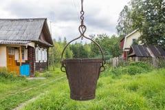 Cubo viejo del hierro Foto de archivo libre de regalías