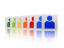 Cubos com sinais coloridos da pessoa Fotografia de Stock