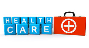 Cubos con la muestra de la atención sanitaria y la caja de los primeros auxilios Fotos de archivo