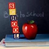 Cubos de ABC y manzana roja Foto de archivo libre de regalías