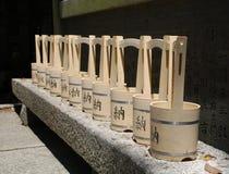 Cubos de agua fuera de la capilla Imagenes de archivo