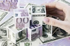 Cubos de euros y de dólares Imagenes de archivo