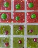 Cubos de gelo das bagas Fotografia de Stock