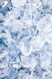 Cubos de gelo. Fundo azul Foto de Stock Royalty Free