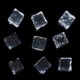 Cubos de hielo aislados en negro Fotografía de archivo