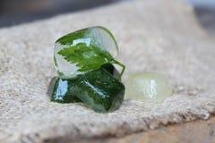 Cubos de hielo con perejil Foto de archivo libre de regalías