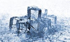 Cubos de hielo de fusión en lluvia Foto de archivo