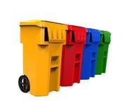 Cubos de la basura multicolores de la basura Foto de archivo libre de regalías