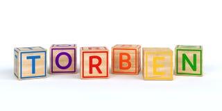 Cubos de madeira isolados do brinquedo com letras com nome Torben Foto de Stock