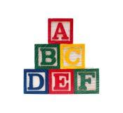 Cubos de madera del alfabeto con las letras de ABC Fotos de archivo libres de regalías