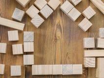 Cubos de madera en la tabla Fotografía de archivo libre de regalías