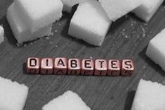 Cubos del azúcar con la diabetes de la palabra Imagen de archivo libre de regalías
