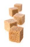 Cubos del azúcar de caña Fotografía de archivo