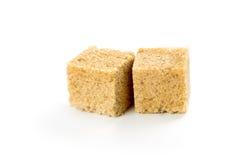 Cubos del azúcar de caña Foto de archivo