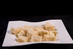 Cubos del queso de parmesano Foto de archivo