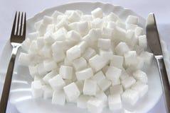 Cubos do açúcar na placa Imagens de Stock Royalty Free