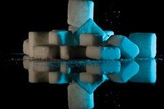 Cubos e reflexões do açúcar Imagens de Stock Royalty Free