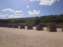 Cubos em uma praia Fotografia de Stock Royalty Free