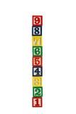 Cubos o bloques de madera del juguete con números aislados Imagen de archivo libre de regalías